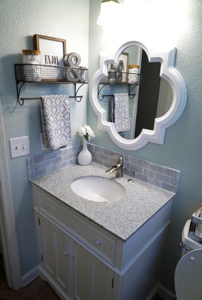 50 half bathroom ideas that will impress your guests and - How to decorate a bathroom counter ...