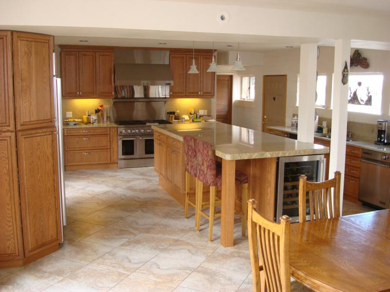 Tiled Floors With Light Oak Cabinets